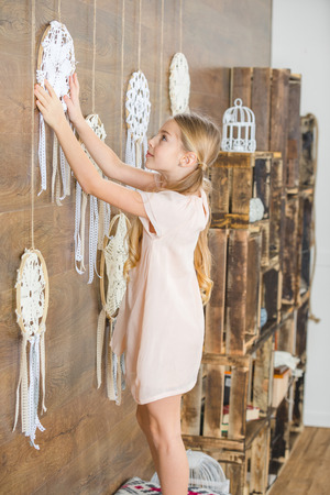 Little girl with white dreamcatchers
