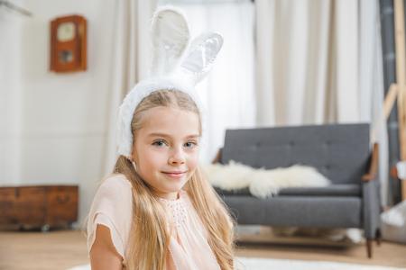 Girl in bunny ears