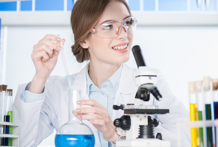 Scientist making experiment Stock Photo