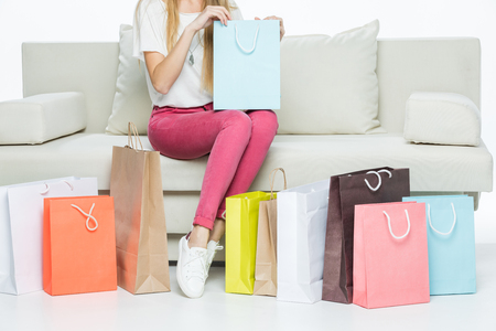lower section view: Woman with shopping bag