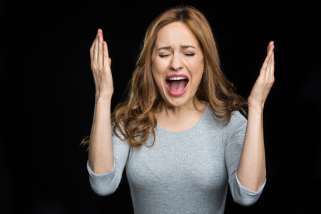 exasperate: Young woman screaming