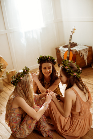 Women in floral wreaths Stock Photo