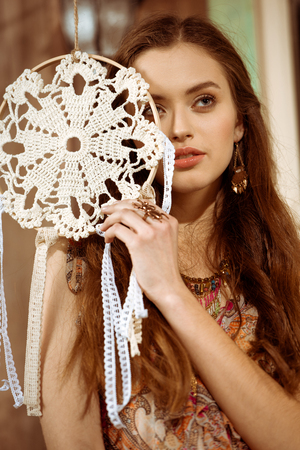 Young woman with dreamcatcher Stock Photo