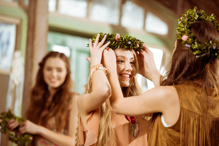 Women with floral wreaths