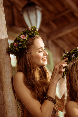 Young woman in floral wreath