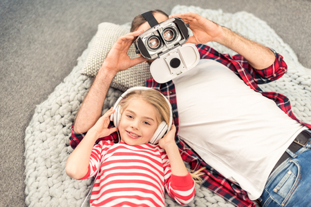 Father and daughter with devices Stock Photo