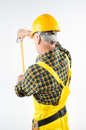 architect tools: Mature workman in hard hat