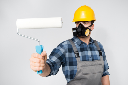 architect tools: Construction worker with paint roller