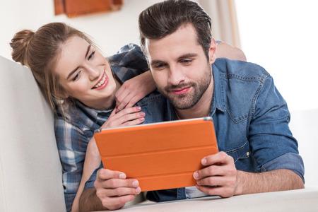 Couple using digital tablet 版權商用圖片