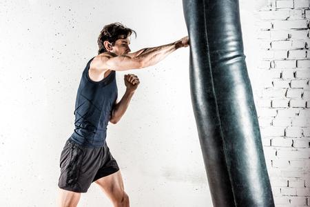 Kickboxer boxing in punching bag