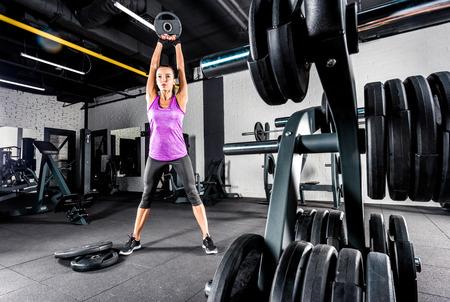 Sportswoman exercising in gym