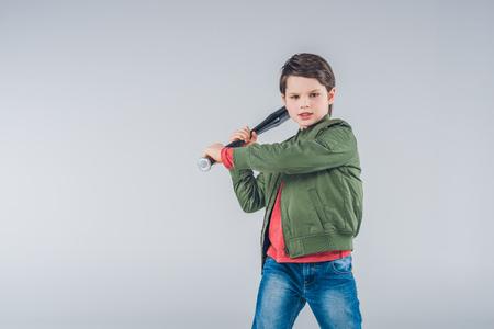 brandishing: Boy brandishing baseball bat standing