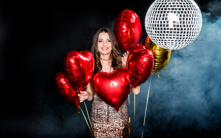 personable: Beautiful woman with shiny balloons
