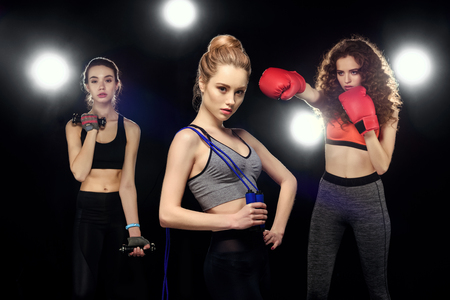 attractive sportswomen with skipping rope, training with dumbbells and boxing 版權商用圖片
