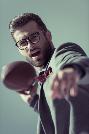 Stylish man with rugby ball Stock Photo