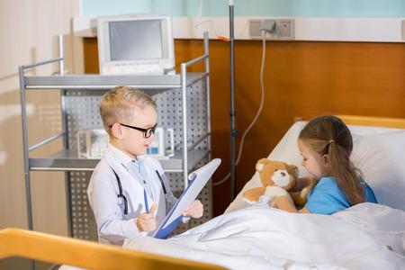 pediatrist: Little boy pretending to be doctor