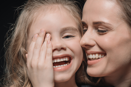 portrait of daughter and mother laughing