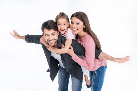 young family with one child having fun together on white Imagens