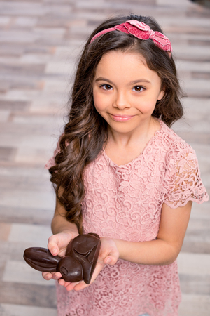 Little girl with chocolate bunny Stock Photo