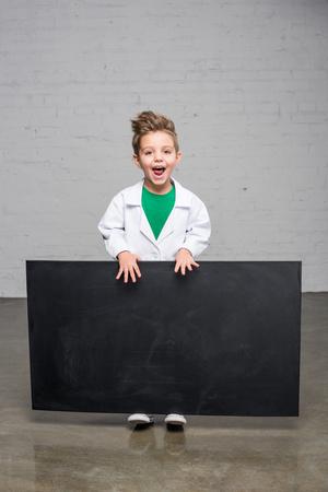 Boy holding blackboard