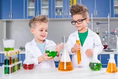 Kids in chemical lab Stock Photo