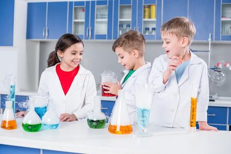 Kids in chemical laboratory 版權商用圖片