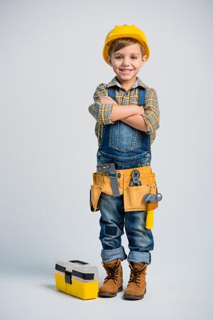 Weinig jongen in hulpmiddelriem Stockfoto - 76172869