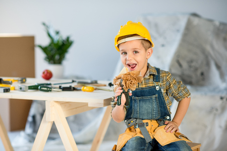 laboring: Boy eating sandwich Stock Photo