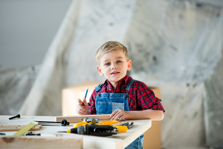 laboring: Little boy with tools