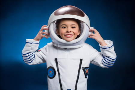 Little girl in space suit Stock Photo