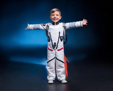 Boy in astronaut costume Stock Photo