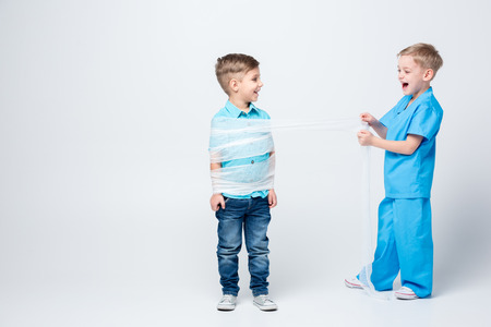 Kids playing doctor and patient