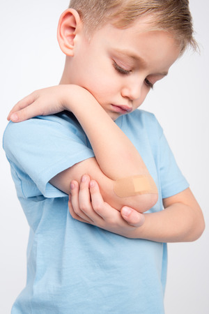 Little boy with patch on elbow