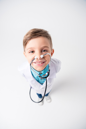 Boy in doctor costume Stock Photo