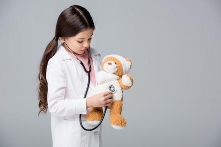 Little girl playing doctor Stock Photo - 76419708