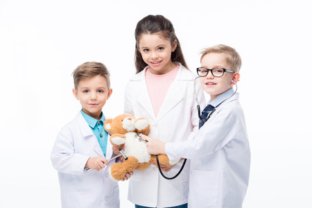 Kids playing doctors Stock fotó