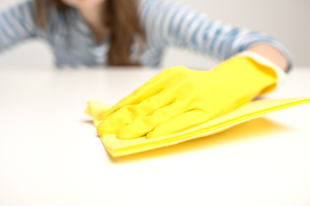 Woman cleaning surface Stock Photo