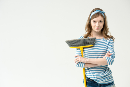 Young woman with broom Banco de Imagens