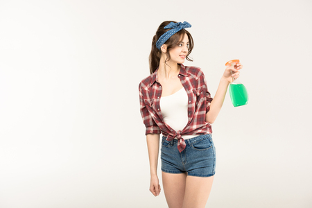 Young woman with spray bottle Stock Photo