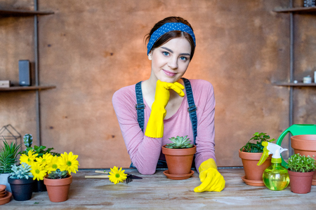 woman with plants in flowerpots Stock Photo