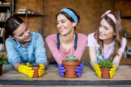 women with plants in flowerpots Stock Photo
