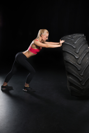 sporty woman with tire Stock Photo