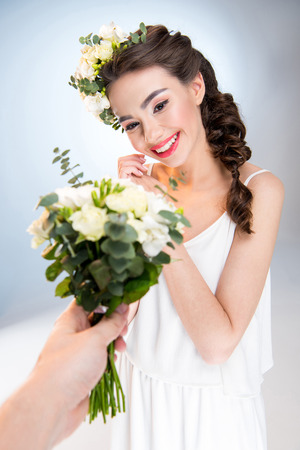 woman receiving flowers Stock Photo