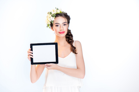 woman showing digital tablet