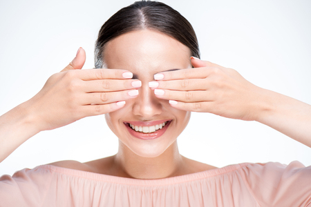 Woman closes eyes with hands
