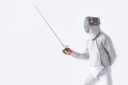 side view of fencer in uniform training with rapier Imagens - 76424469