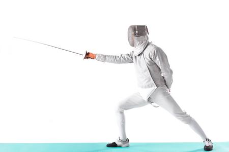 fencer in uniform trainign with rapier in hand on white