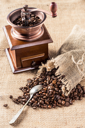 coffee mill with aromatic coffee beans in sacking bag