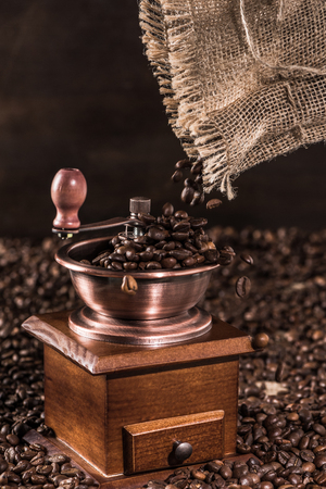 coffee mill with aromatic coffee beans on brown Stok Fotoğraf
