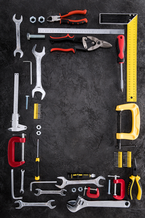 top view of set of various work tools on black Stock Photo